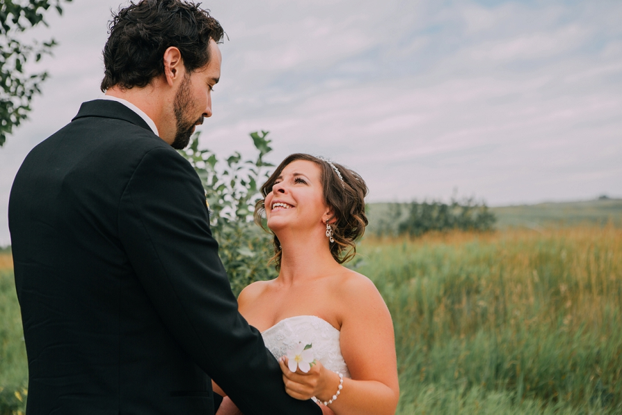bride tearing up first look nose hill park calgary wedding photographers anna michalska