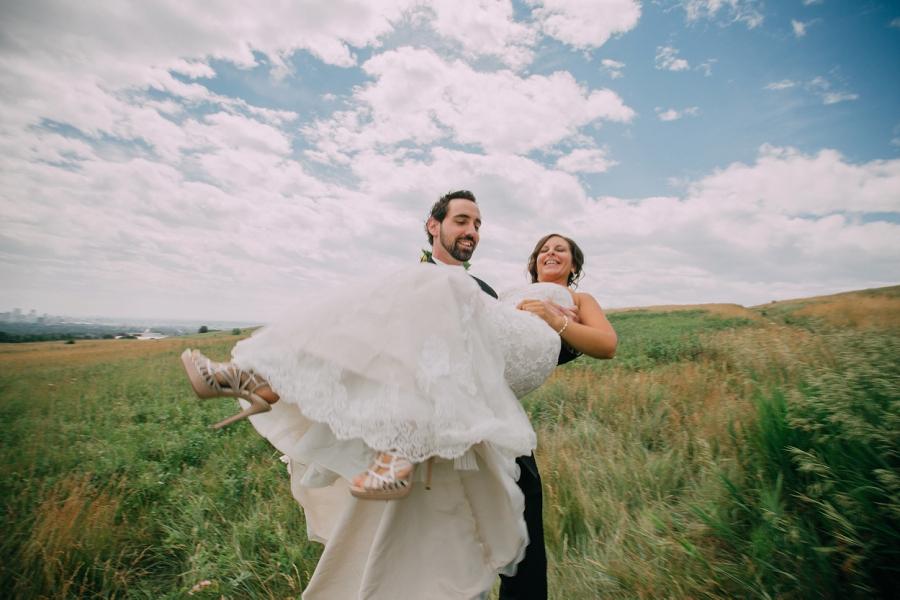 groom escorts bride calgary wedding photographer anna michalska