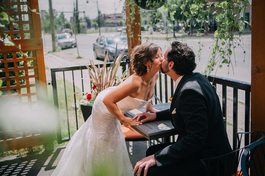 bride groom patio kiss 4th spot kitchen and bar calgary wedding photographer anna michalska