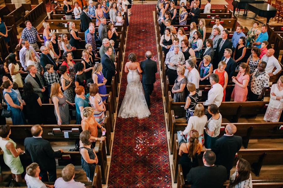 bride walks down aisle birds eye view knox united church calgary wedding photographer anna michalska