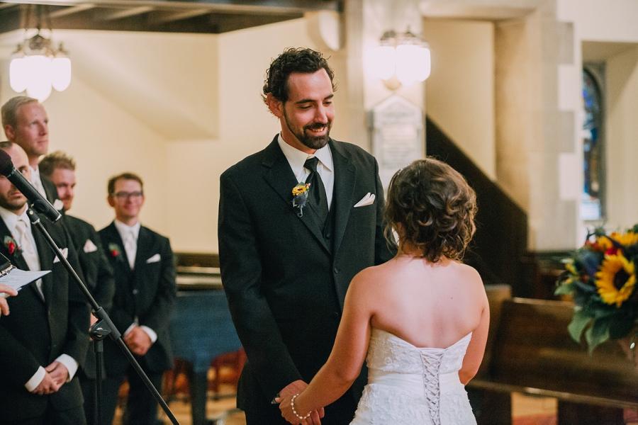 groom sees bride walking down aisle knox united church calgary wedding photographer anna michalska