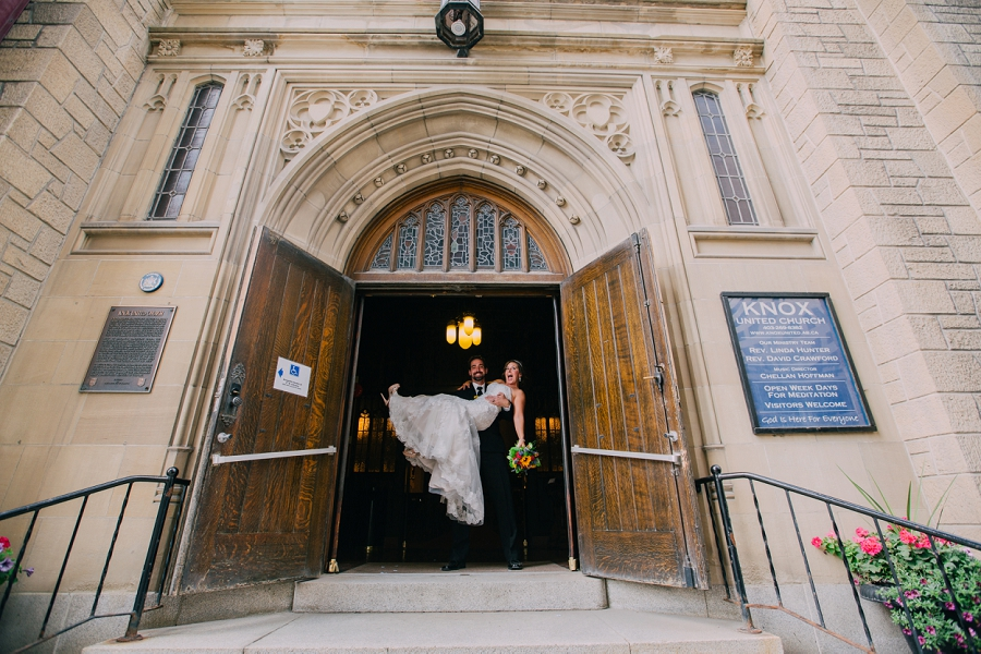 bride and groom walk out of church knox united church calgary wedding photographer anna michalska