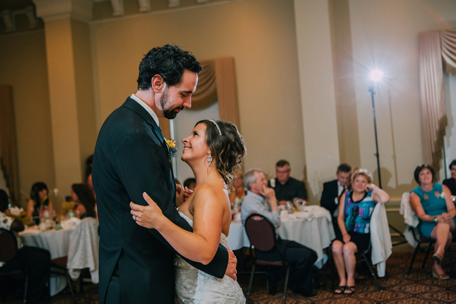 bride smiling first dance ramada plaza hotel calgary wedding photographer anna michalska