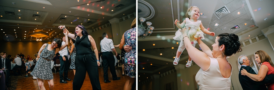 young girl being tossed in the air dancing ramada plaza hotel calgary wedding photographer anna michalska