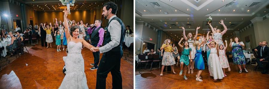 ramada plaza hotel calgary wedding photographer anna michalska bride bouquet toss