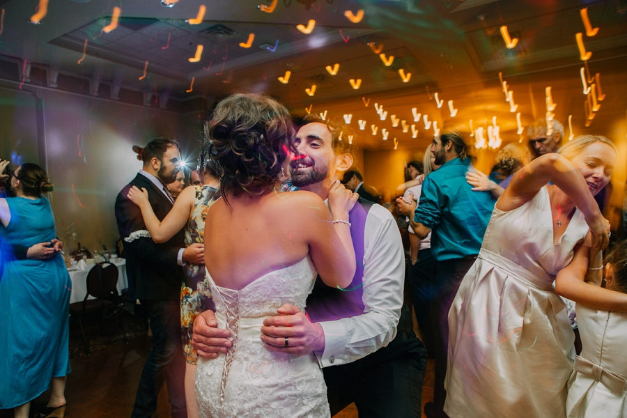 tall groom dancing with bride ramada plaza hotel calgary wedding photographer anna michalska