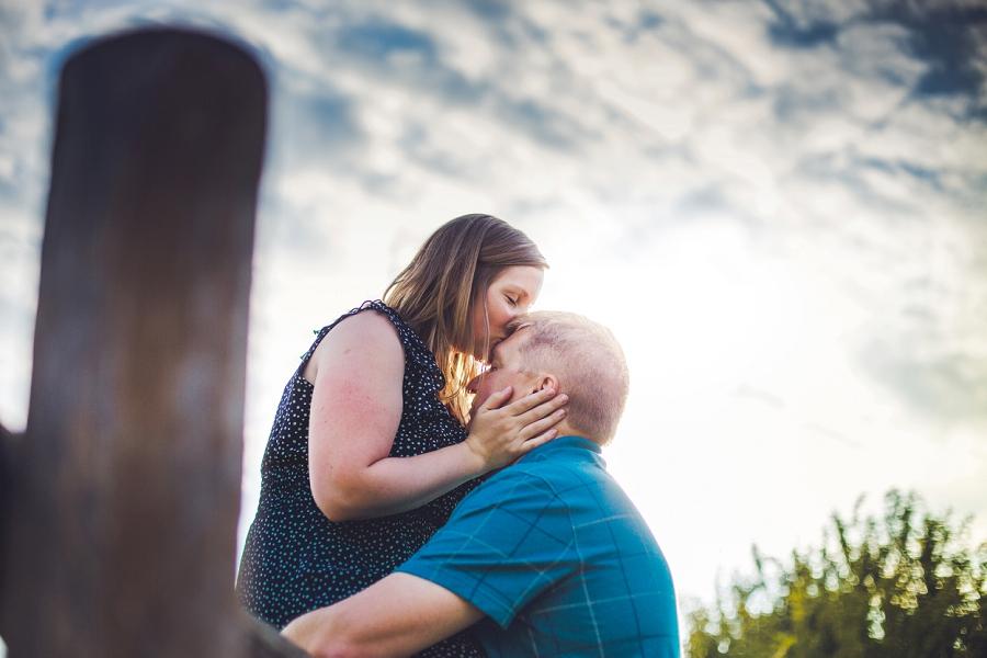 bride kiss on groom's head fish creek park engagement session calgary wedding photographer anna michalska