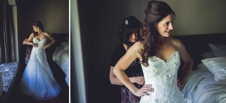 bride getting dressed calgary wedding photographer anna michalska