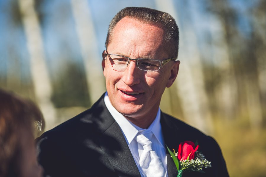 groom smiling calgary wedding photographer anna michalska