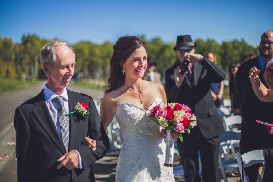 bride walking down aisle calgary wedding photographer anna michalska
