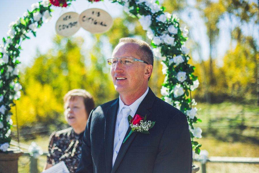 groom sees bride for the first time down aisle cowboy themed wedding calgary wedding photographer anna michalska