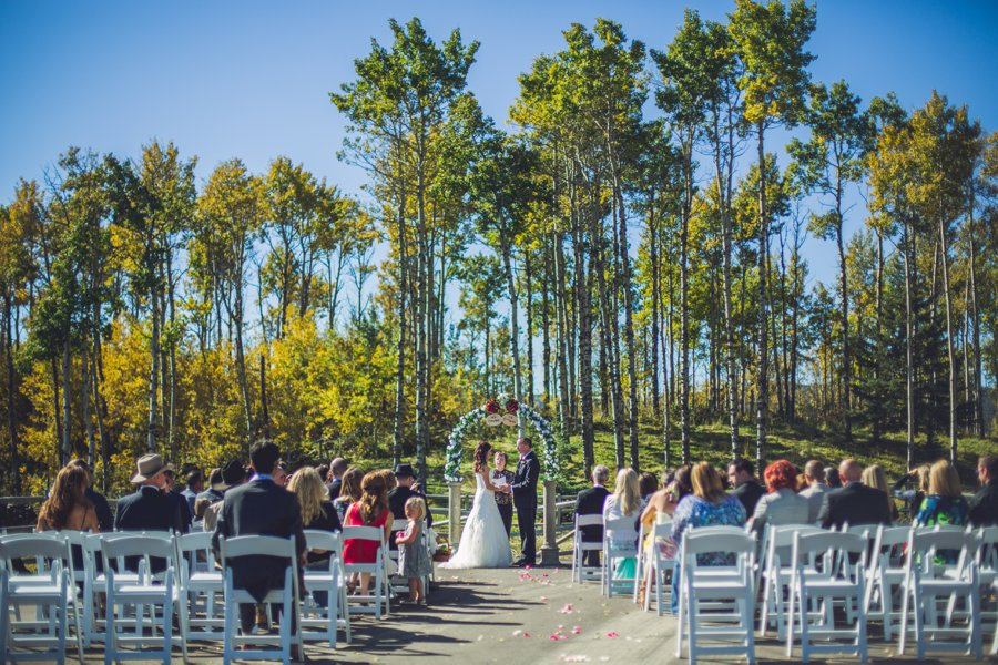 wedding ceremony fall outside cowboy themed wedding calgary wedding photographer anna michalska