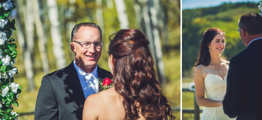 smiling bride groom at each other cowboy themed wedding calgary wedding photographer anna michalska