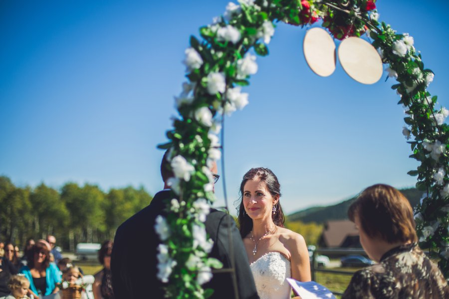 bride looking at groom cowboy themed wedding calgary wedding photographer anna michalska