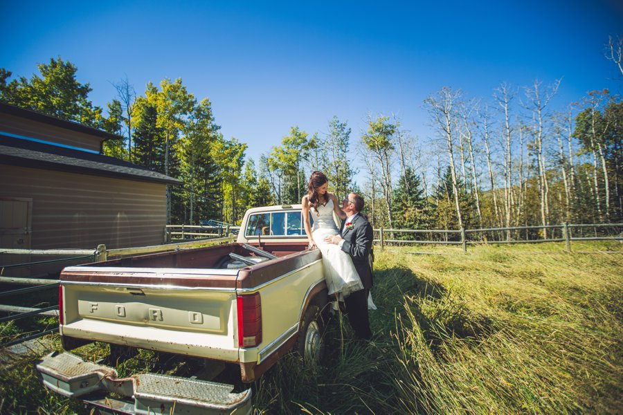 bride on old ford truck cowboy themed wedding calgary wedding photographer anna michalska