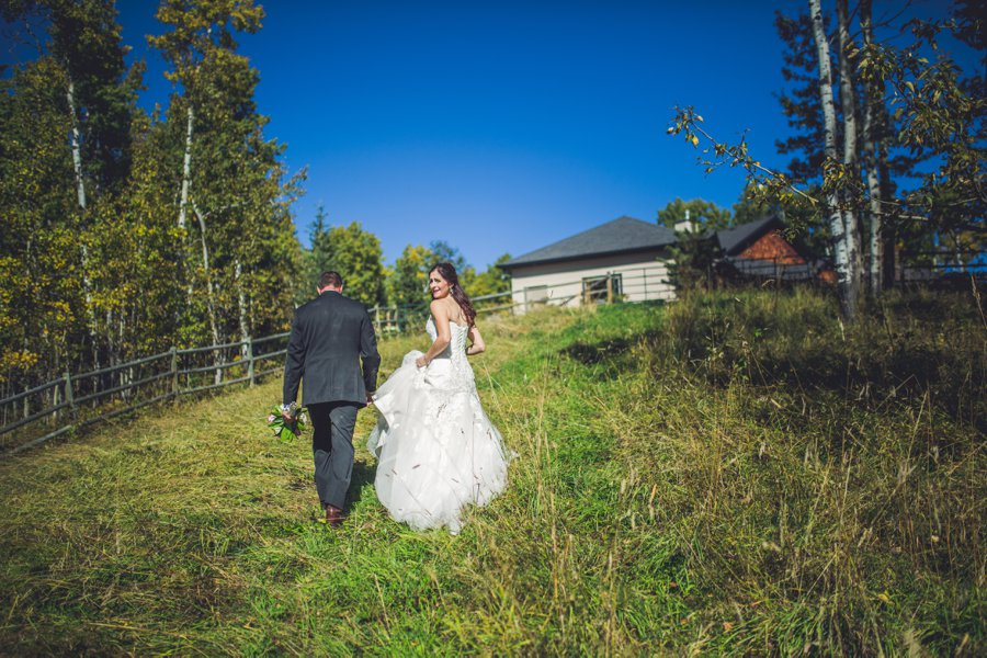 bride and groom walking uphill calgary wedding photographer anna michalska