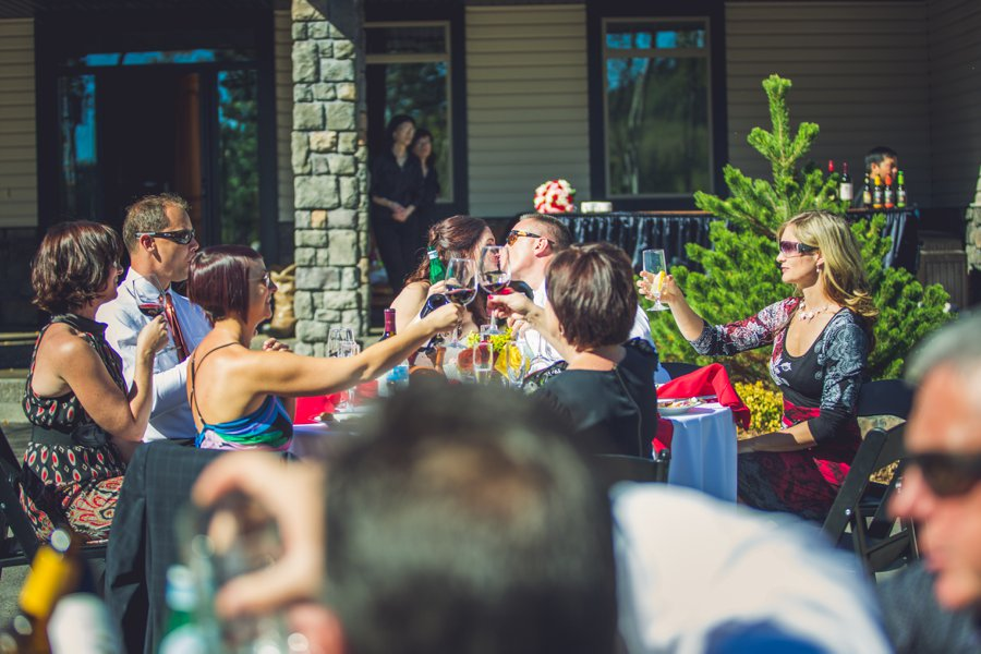 reception at home bride groom kiss calgary wedding photographer anna michalska