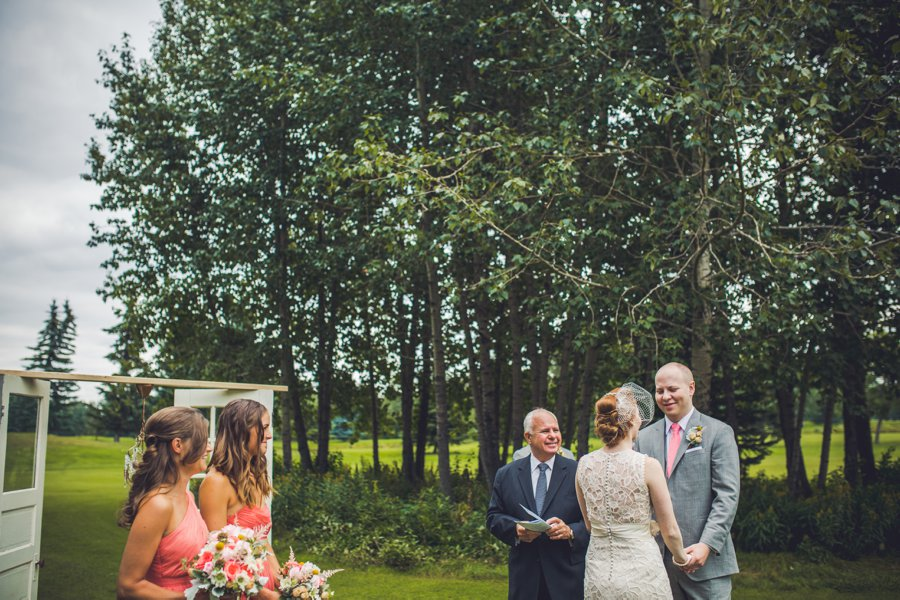 groom looking at bride elbow springs golf club calgary wedding photographer anna michalska