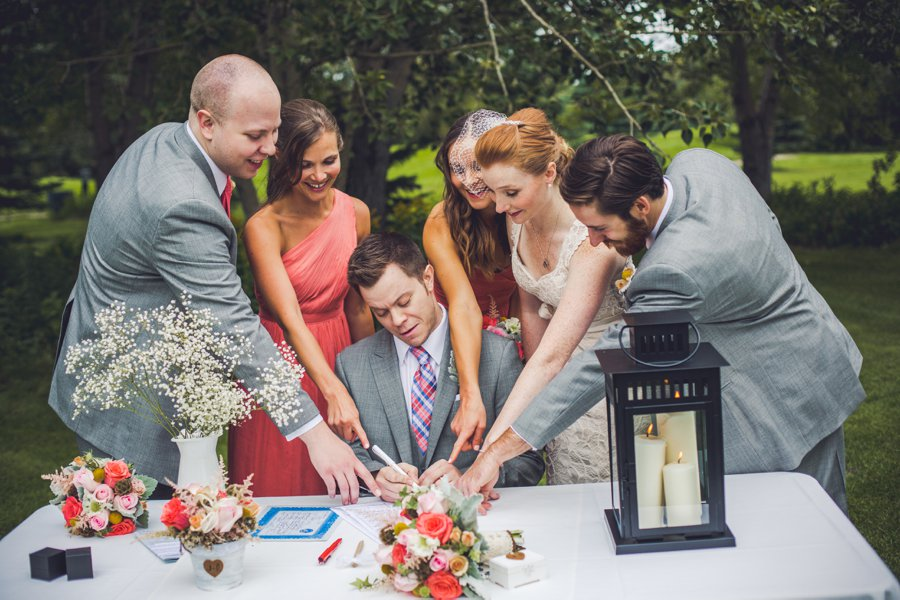 signing of registry elbow springs golf club calgary wedding photographer anna michalska