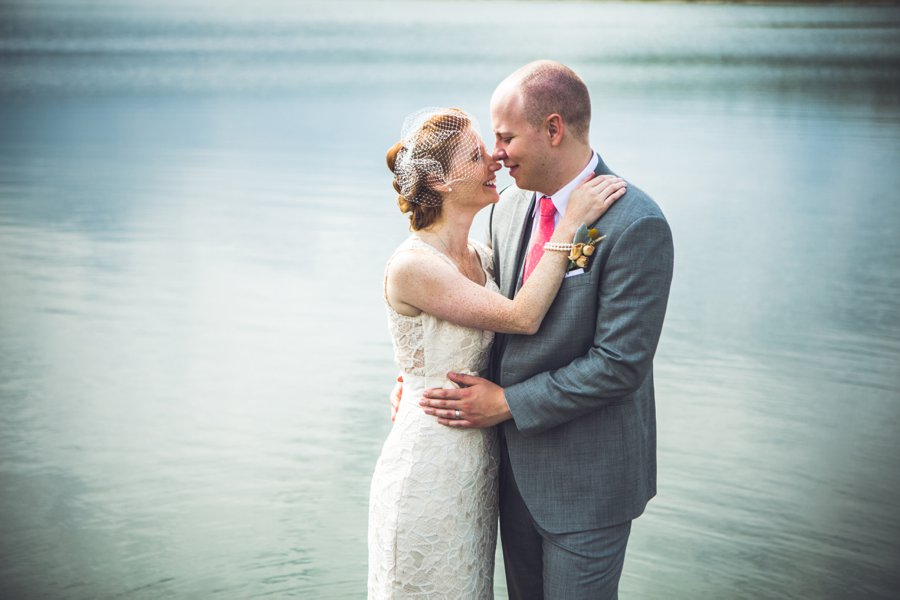 bride groom over lake elbow springs golf club calgary wedding photographer anna michalska