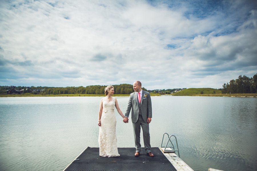 bride groom on dock over lake elbow springs golf club calgary wedding photographer anna michalska