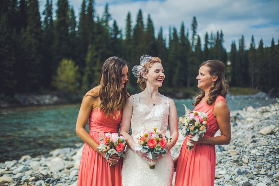 bride bridesmaids laughing river calgary wedding photographer anna michalska
