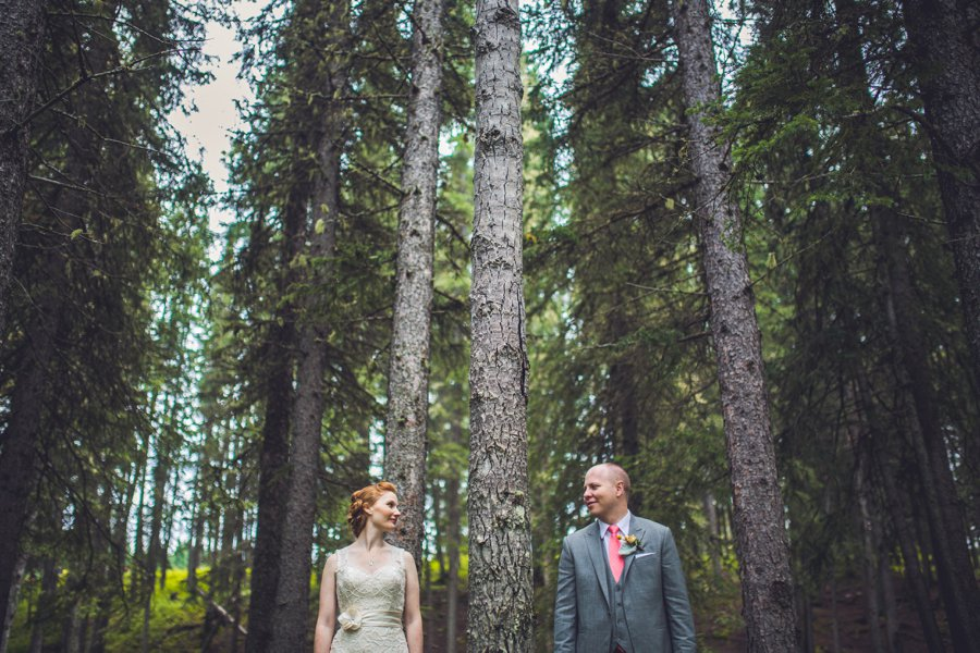 bride groom in forest calgary wedding photographer anna michalska
