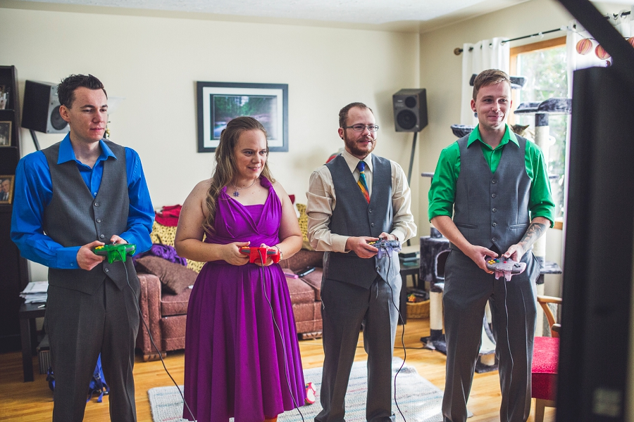 bridal party playing video games calgary wedding photographer anna michalska