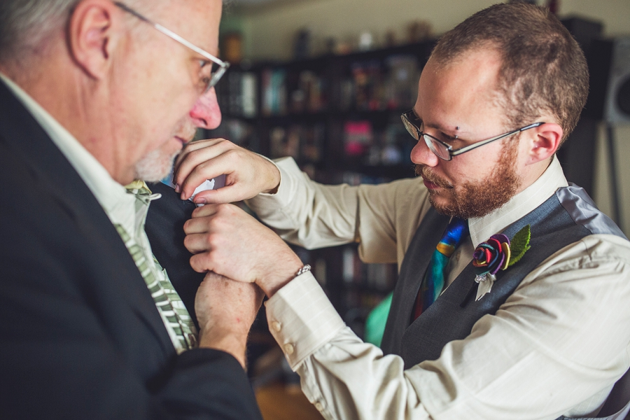groom putting on dad's boutonniere calgary wedding photographer anna michalska
