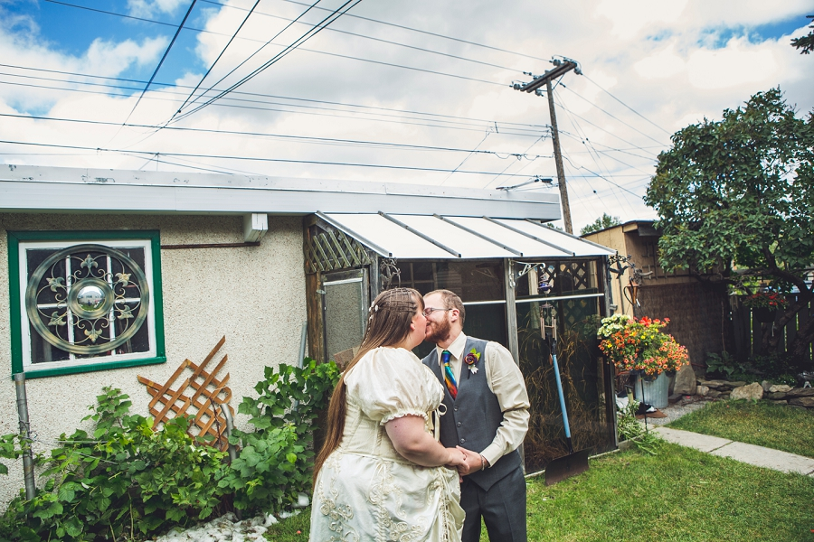 bride groom kiss first look calgary wedding photographer anna michalska