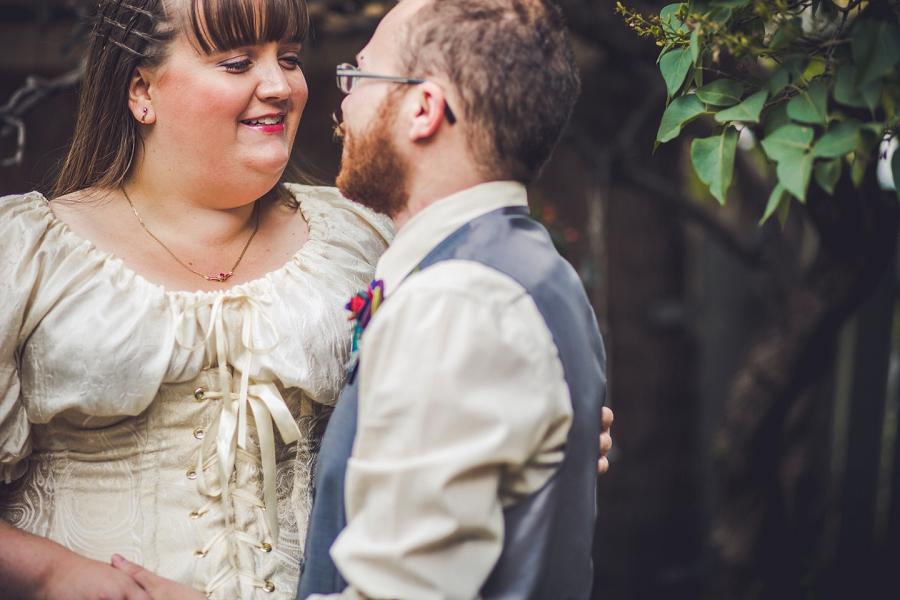 bride looking at groom calgary wedding photographer anna michalska