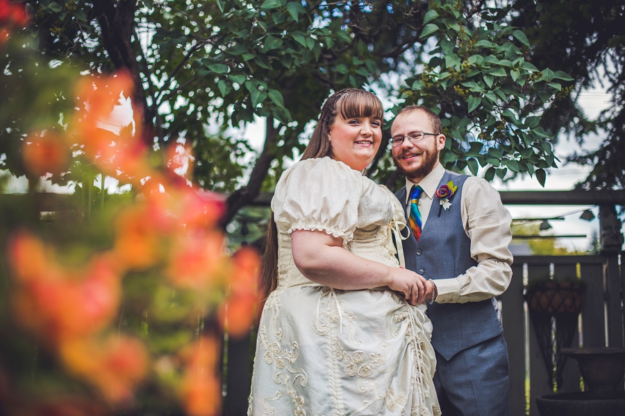 bride groom among flowers calgary wedding photographer anna michalska