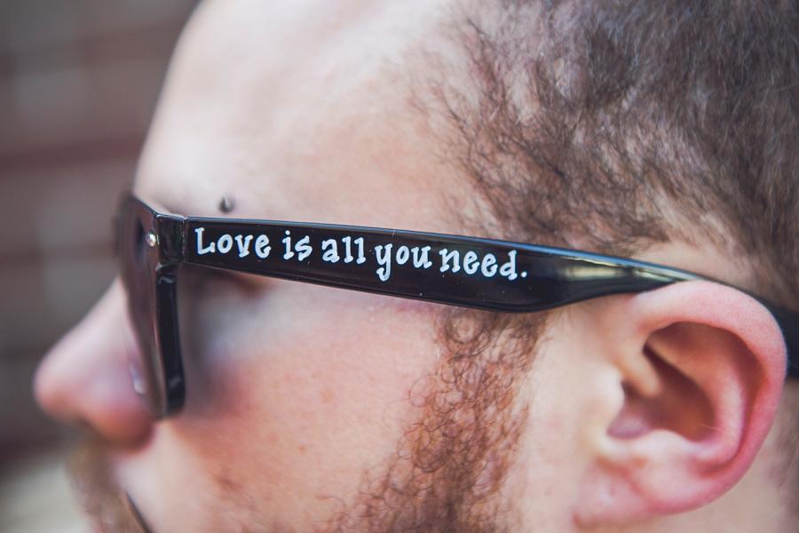 love is all you need sunglasses groom calgary wedding photographer anna michalska