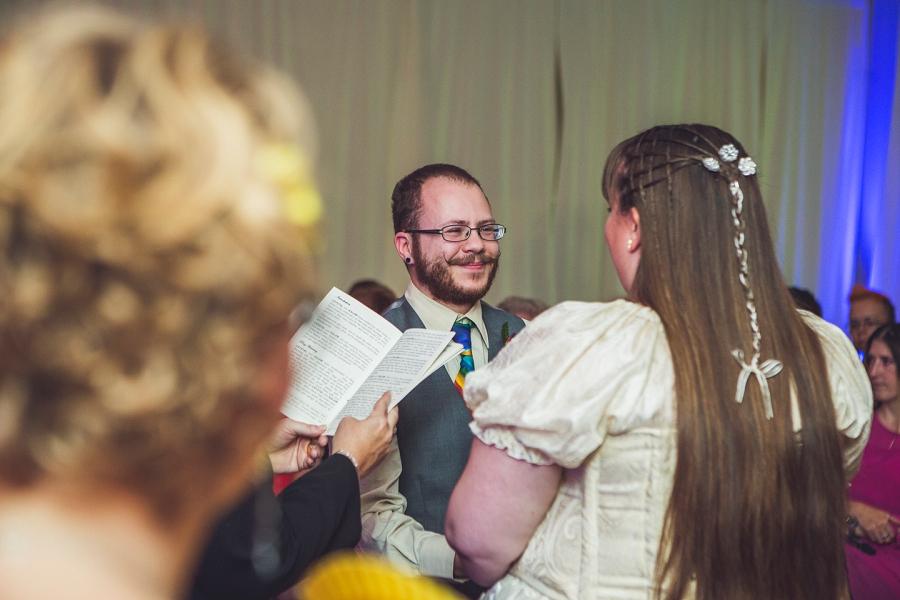 groom smiles at bride calgary wedding photographer anna michalska