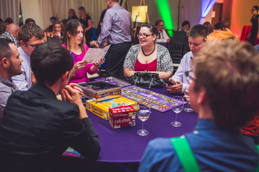 guests playing board games calgary wedding photographer anna michalska