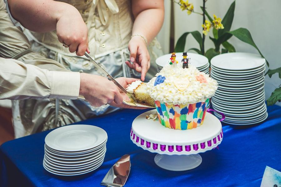 lego cake cutting of wedding cake calgary wedding photographer anna michalska