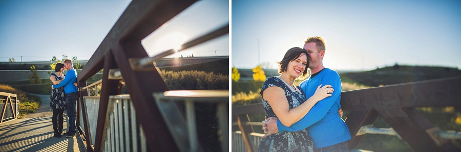 kissing couple bridge summer engagement session calgary wedding photographer anna michalska