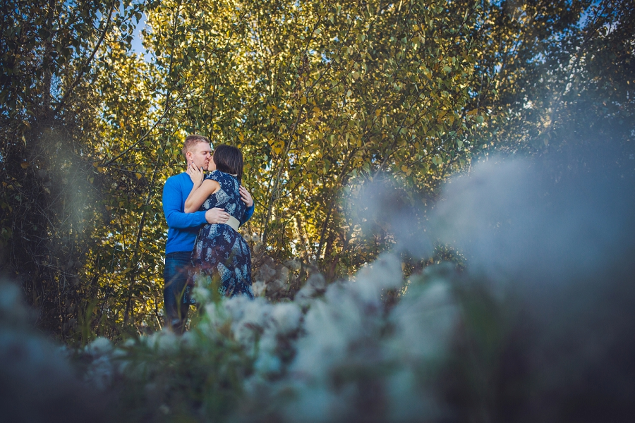 couple with flowers summer engagement session calgary wedding photographer anna michalska