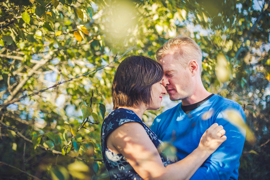 couple snuggling summer engagement session calgary wedding photographer anna michalska