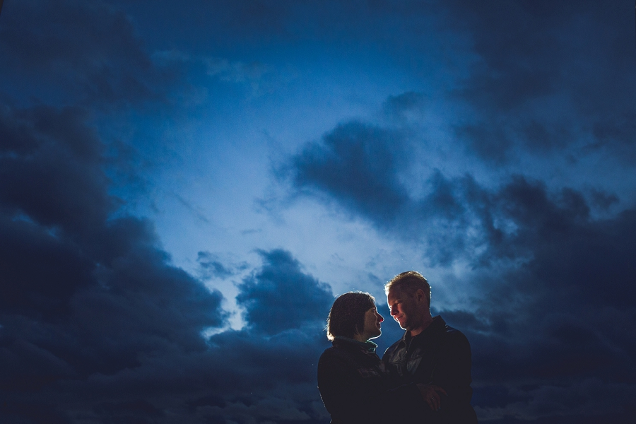 couple stormy skies summer engagement session calgary wedding photographer anna michalska
