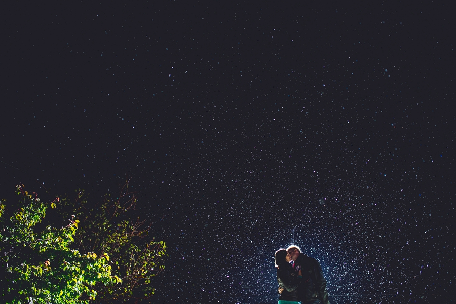 couple kissing with snow summer engagement session calgary wedding photographer anna michalska
