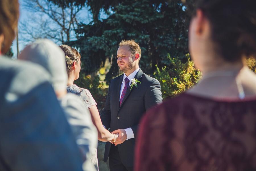 groom looking at groom downtown calgary elopement wedding photographer anna michalska