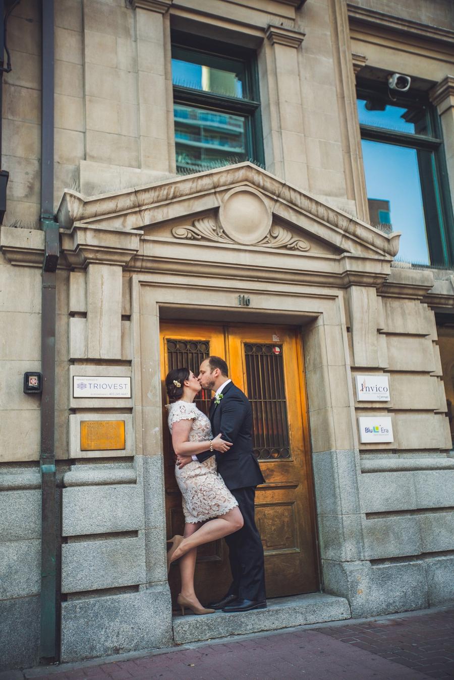 bride groom kiss gold doors stephen avenue calgary wedding photographer anna michalska