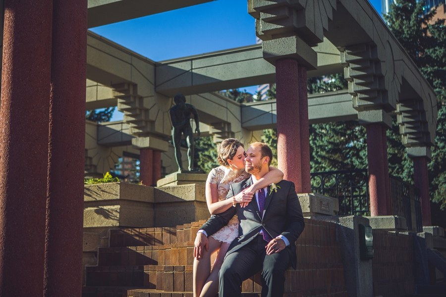 calgary wedding photographer anna michalska bride groom kiss olympic plaza