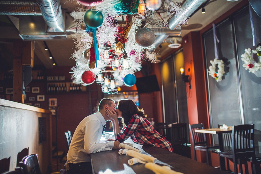 cibo calgary restaurant engagement photos winter kiss
