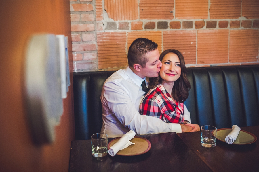 cibo calgary restaurant engagement photos groom kisses bride on cheek