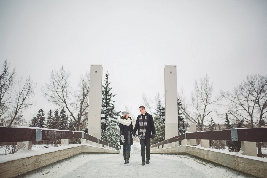 prince's island park bridge winter engagement photos calgary engagement photographer anna michalska
