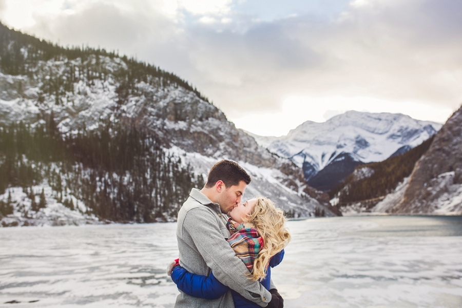 snow covered mountain frozen lake winter engagement photo banff