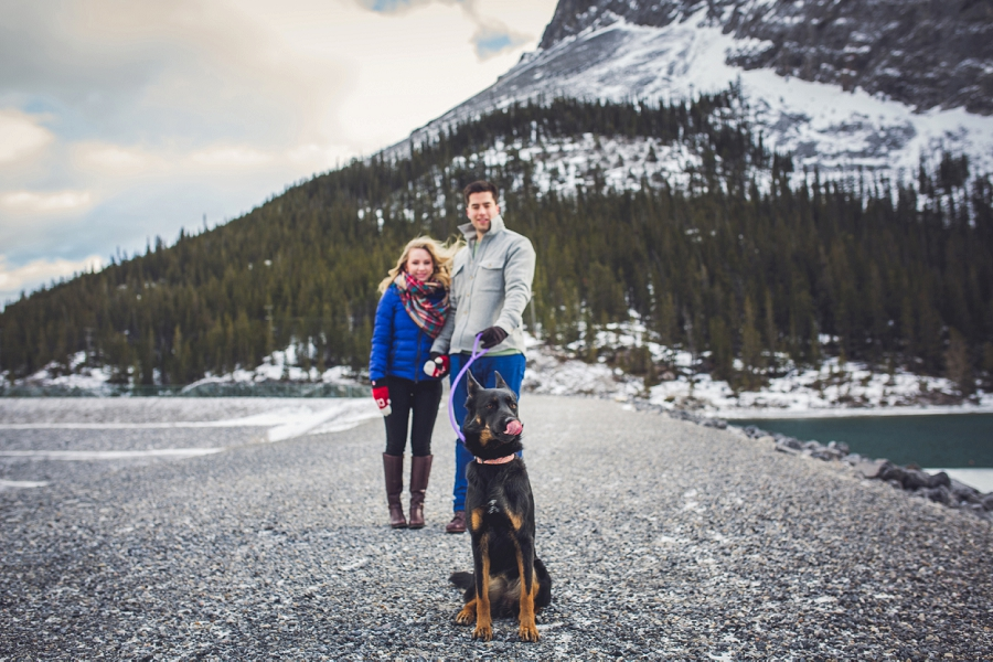 puppy licking nose mountain view winter engagement photo