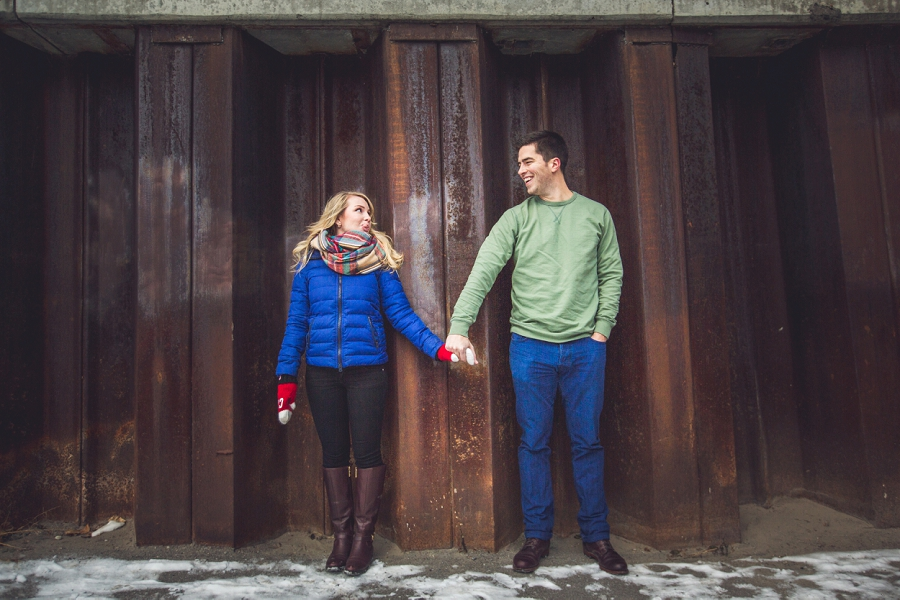 couple silly faces holding hands winter engagement photos
